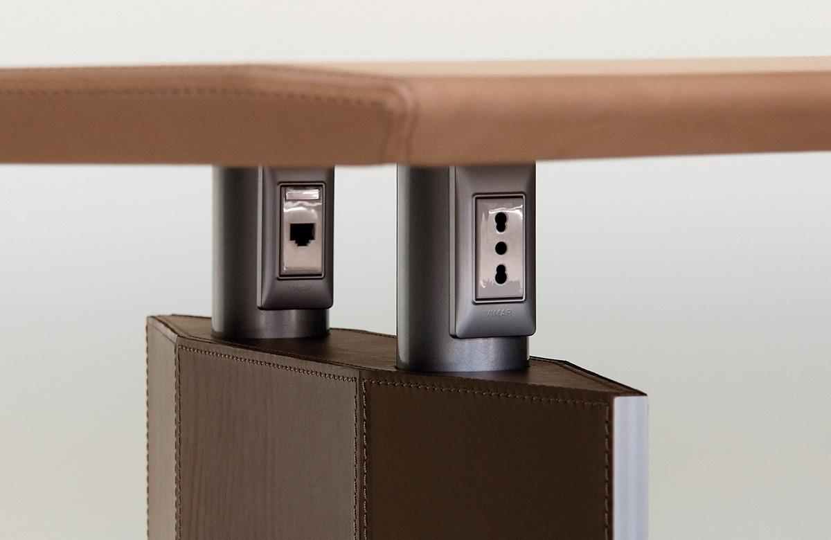 542 Arrangement for sockets on table base